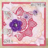 Kartka uniwersalna z fioletowym kwiatem.