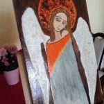 Obraz - Zamyślony anioł na desce A - zbliżenie boczne