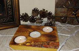 Świecznik na desce drewnianej