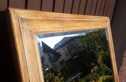 Lustro w drewnianej brązowej ramie
