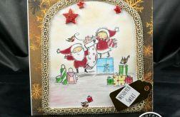 Kartka Mikołaj pakujący prezenty