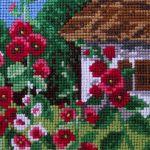 """Obraz haftem malowany """"Malwy przed chatą"""" -"""