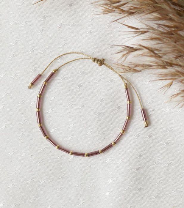 Bransoletka z fioletowymi i złotymi koralikami - Regulowana bransoletka na rękę