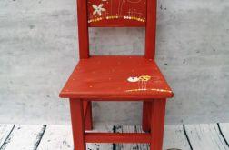 czerwone krzesełko z oparciem kot