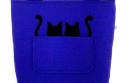 Two black cats on blue