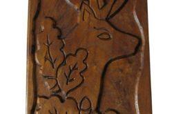 Obraz jeleń z gałązką dębu