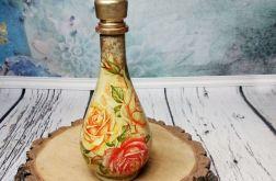 Postarzana złota szklana karafka z różami