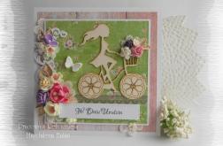 Kartka z dziewczyną na rowerze