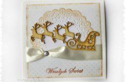 Kartka świąteczna z saniami i reniferami