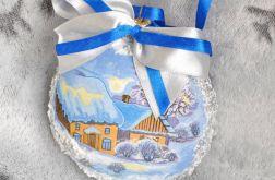 Śnieżny medalion z zimowym widokiem
