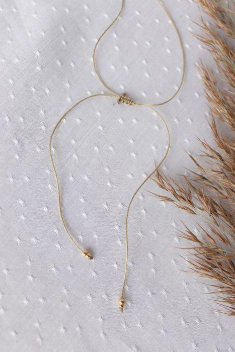 Naszyjnik z brązową perłą na kawowym sznureczku - regulowany naszyjnik