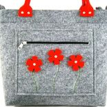 Red flowers in pocket/strap