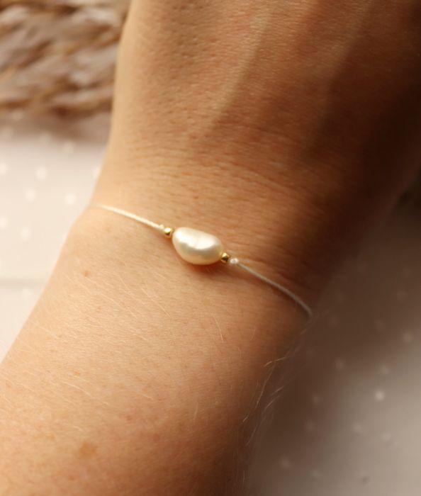 Bransoletka na kremowym sznureczku z perłą - Perła hodowlana na kremowym sznureczku