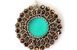 Wisiorek złoto- brązowy z niebieskim oczkie