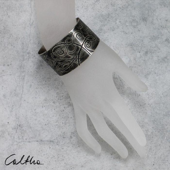 Metalowa bransoleta - zawijasy 151001-05