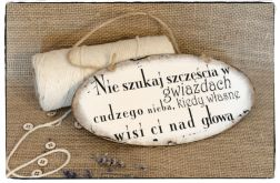 Tabliczka z napisem Poszukiwanie szczęścia