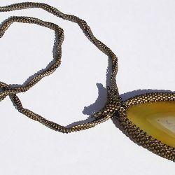 Agat w koralikach bursztynowy transparentny