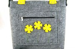 Yellow flowers in pocket/strap