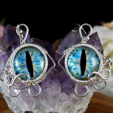 Srebrne kolczyki ze smoczym okiem niebieskie