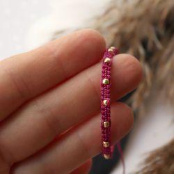 Różowa wyplatana bransoletka ze sznureczka