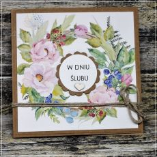 Ślubna kartka z kwiatowym wieńcem