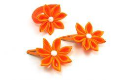 pomarańczowe spinki i gumka