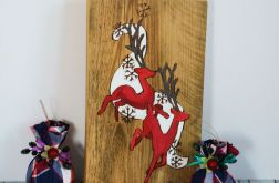 Obraz na drewnie - Jelenie wśród śnieżynek