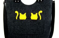 Two small yellow cat/strap