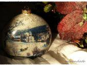 Bombka medalion sanie pośród drzew