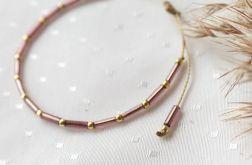 Bransoletka z fioletowymi i złotymi koralikami
