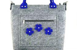 Blue flowers in pocket/strap