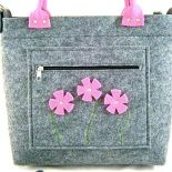 Pink flowers in pocket/strap