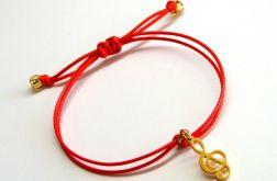 Czerwona z kluczem wiolinowym